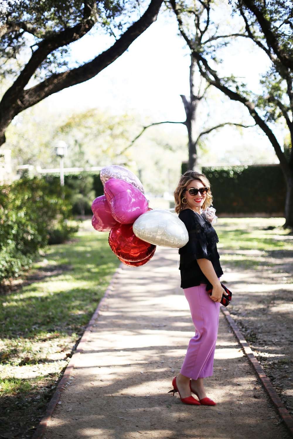 J.Crew Pink pants, hunter bell fringe top, red shiny ponies and DVF lip clutch. Valentine's Day Fashion 7.jpg