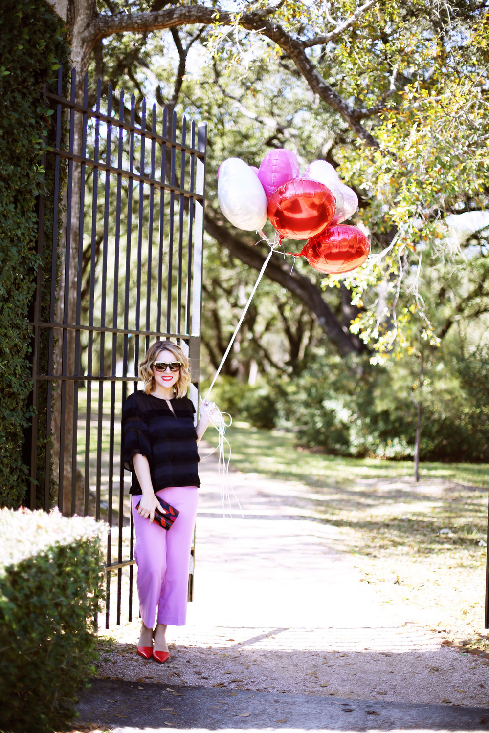 J.Crew Pink pants, hunter bell fringe top, red shiny ponies and DVF lip clutch. Valentine's Day Fashion 6.jpg