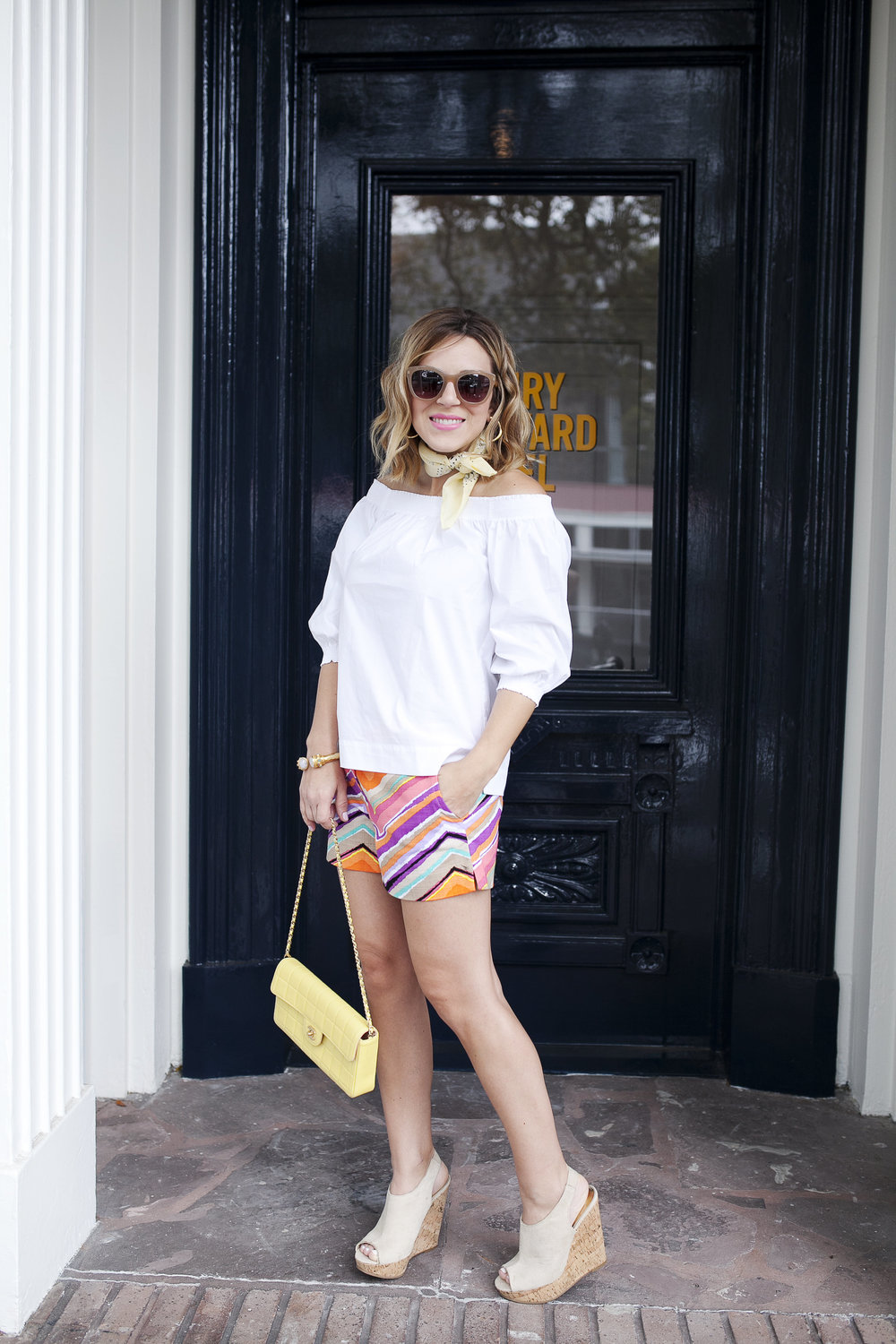 Trina Turk Set with off the shoulder white top and colored shorts. Vintage yellow Chanel bag at Henry Howard Hotel 7.jpg