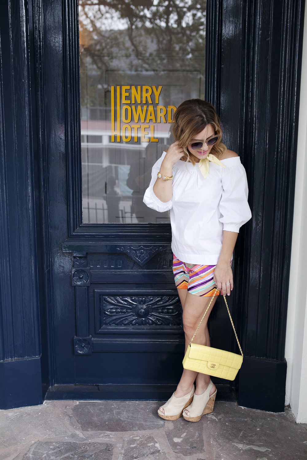 Trina Turk Set with off the shoulder white top and colored shorts. Vintage yellow Chanel bag at Henry Howard Hotel 2.jpg