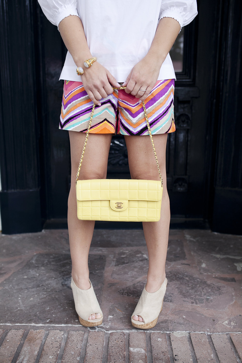 Trina Turk Set with off the shoulder white top and colored shorts. Vintage yellow Chanel bag at Henry Howard Hotel 6.jpg