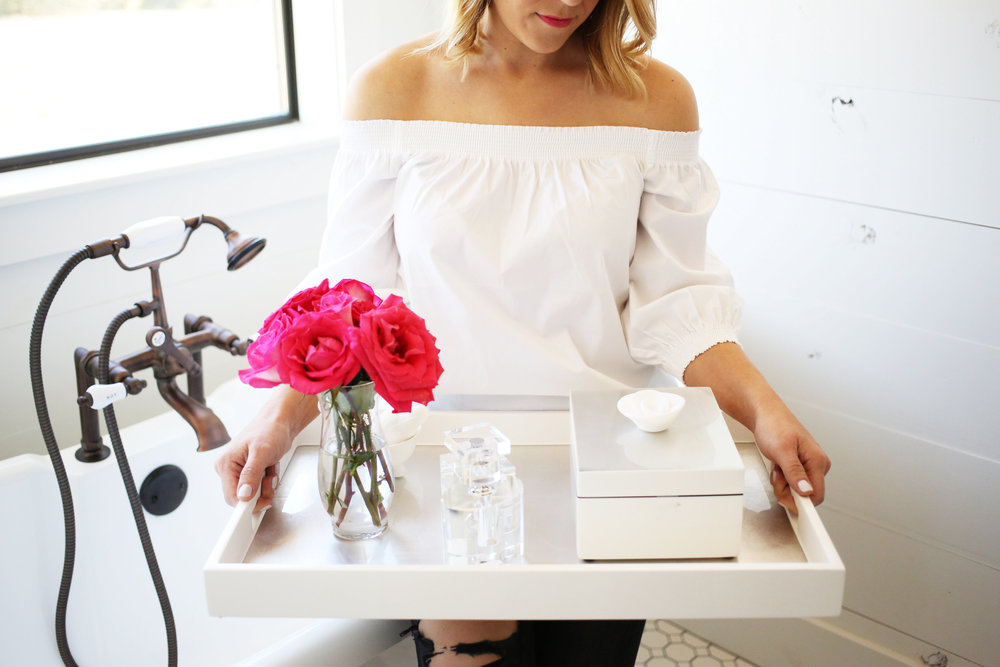 Bathroom with shiplap and accessories on white tray & Trina Turk off the shoulder white top. 1.jpg