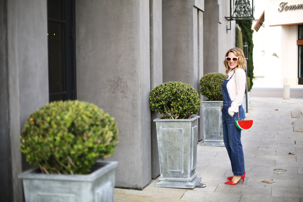Denim overalls with watermelon clutch: white sunglasses: red pumps 1.jpg
