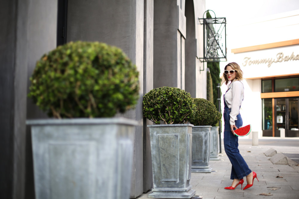 Denim overalls with watermelon clutch: white sunglasses: red pumps 5.jpg