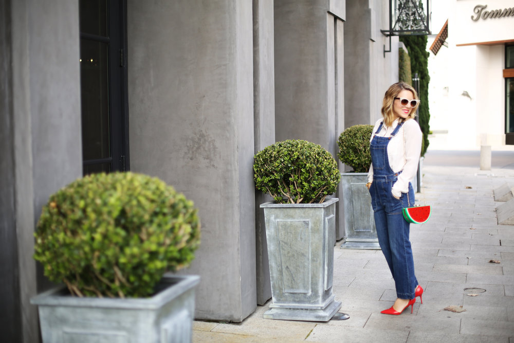 Denim overalls with watermelon clutch: white sunglasses: red pumps 2.jpg