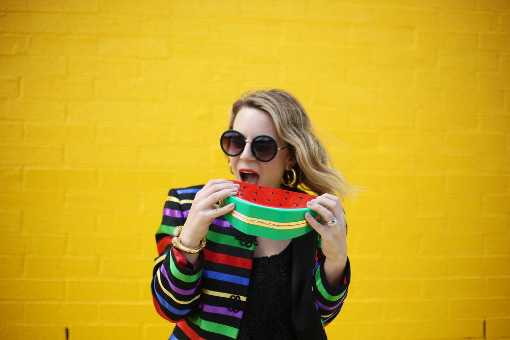 yumi kim black romper with rainbow colored jacket and watermelon clutch 6.jpg