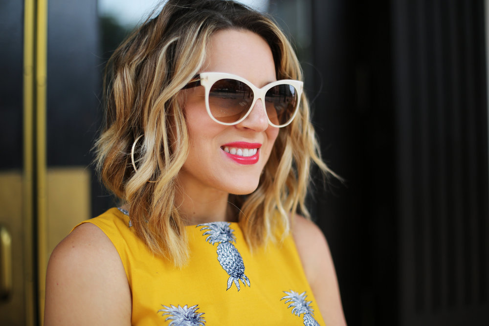 yellow pineapple dress with white sunglasses and black and white clutch-1.jpg