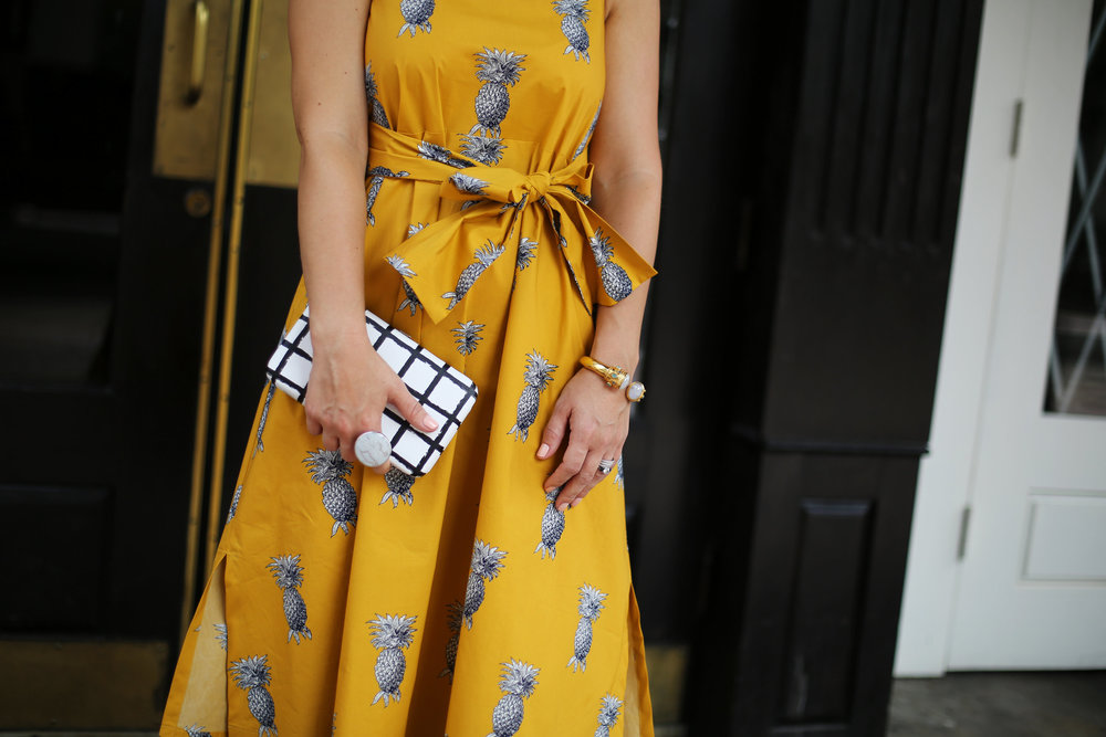yellow pineapple dress with white sunglasses and black and white clutch-5.jpg