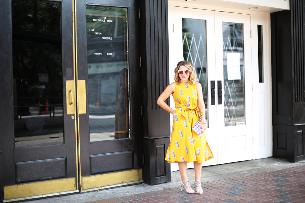 yellow pineapple dress with white sunglasses and black and white clutch-11.jpg