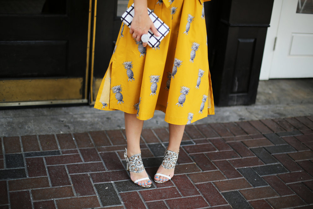 yellow pineapple dress with white sunglasses and black and white clutch-4.jpg