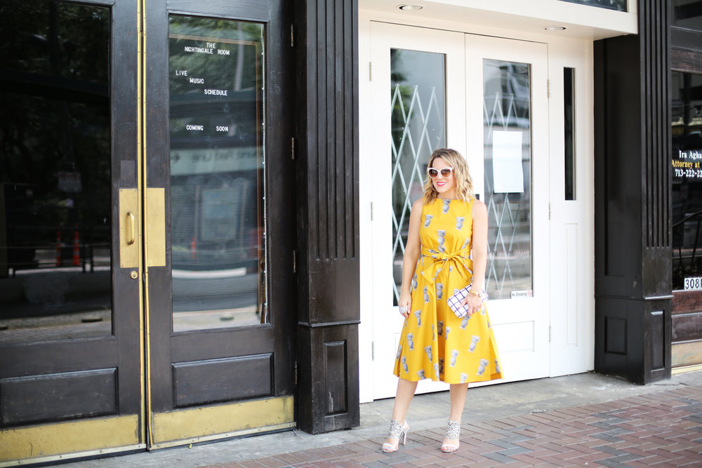 yellow pineapple dress with white sunglasses and black and white clutch-12.jpg