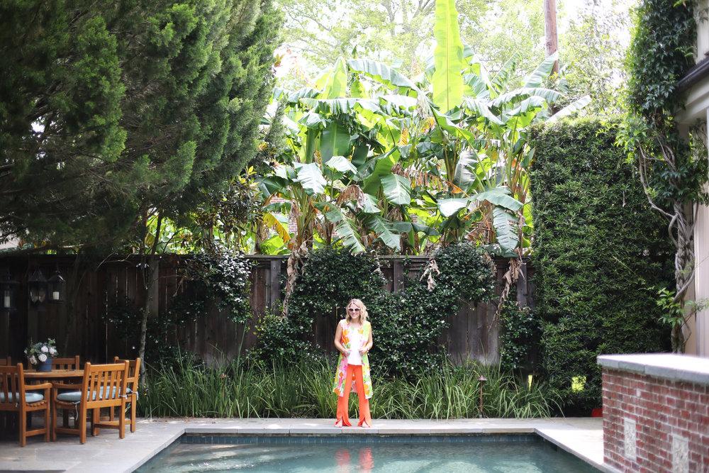 floral vest with trina turk orange slit pants and summer floats 3.jpg