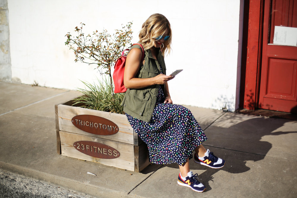 polka dot navy dress:J.Crew: Sneakers: Red backpack:Green vest-1.jpg