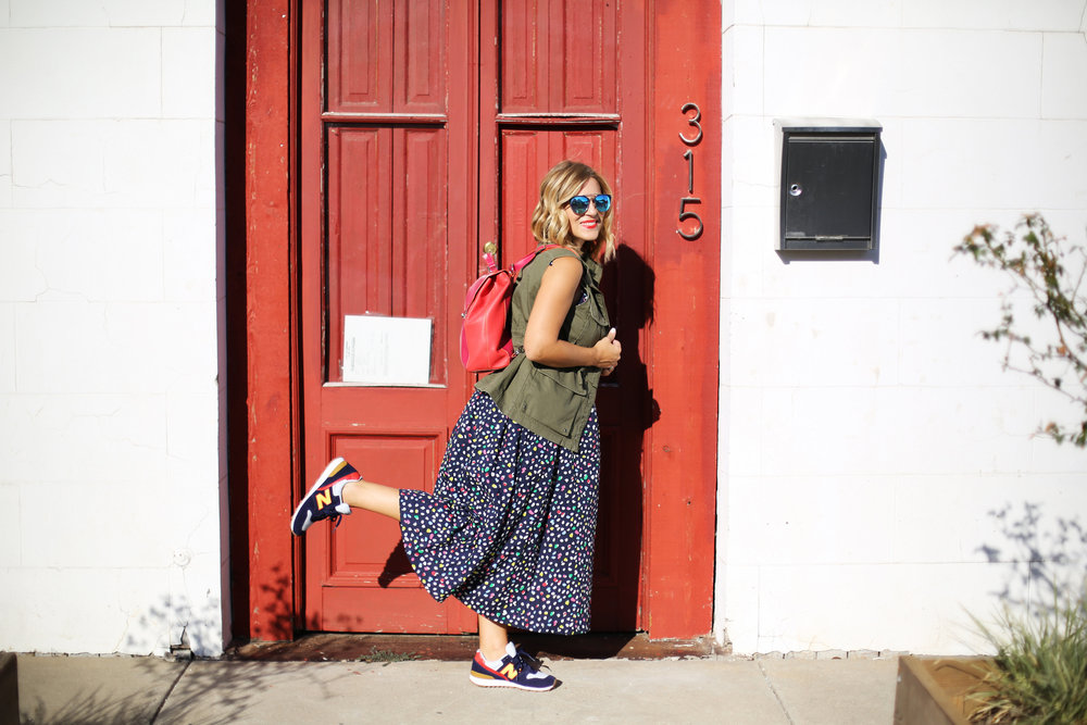 polka dot navy dress:J.Crew: Sneakers: Red backpack:Green vest-4.jpg