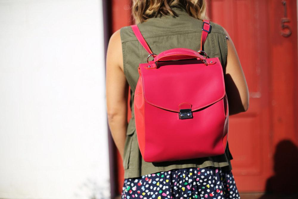 polka dot navy dress:J.Crew: Sneakers: Red backpack:Green vest-8.jpg