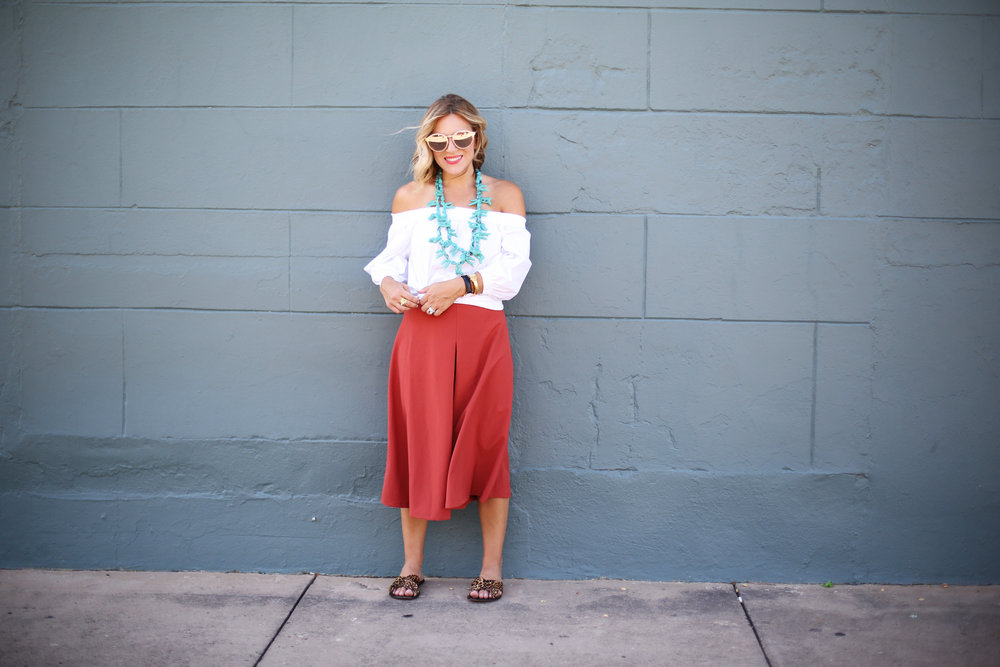 Turquoise necklace:white off the shoulder top: orange pants: football game-10.jpg