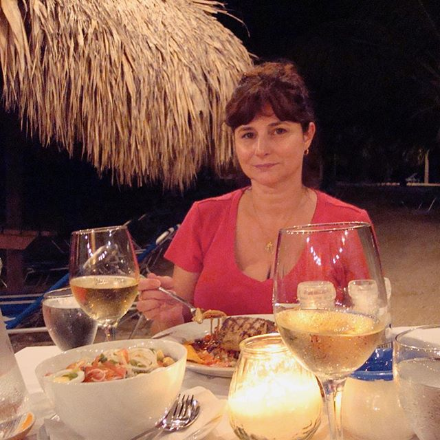 A Night of Wine and Roses - Thanksgiving dinner on the beach. It was the day I bought my place in Curacao. Giving thanks for paradise and my long time friend, Jeffrey. #friendship #paradiselife #bluebaybeach #curacao_island #dinnerwithfriends #thankfulness #beautifulbeaches #seasidefun #oceanbreezes🌊 #warmweatheryearround