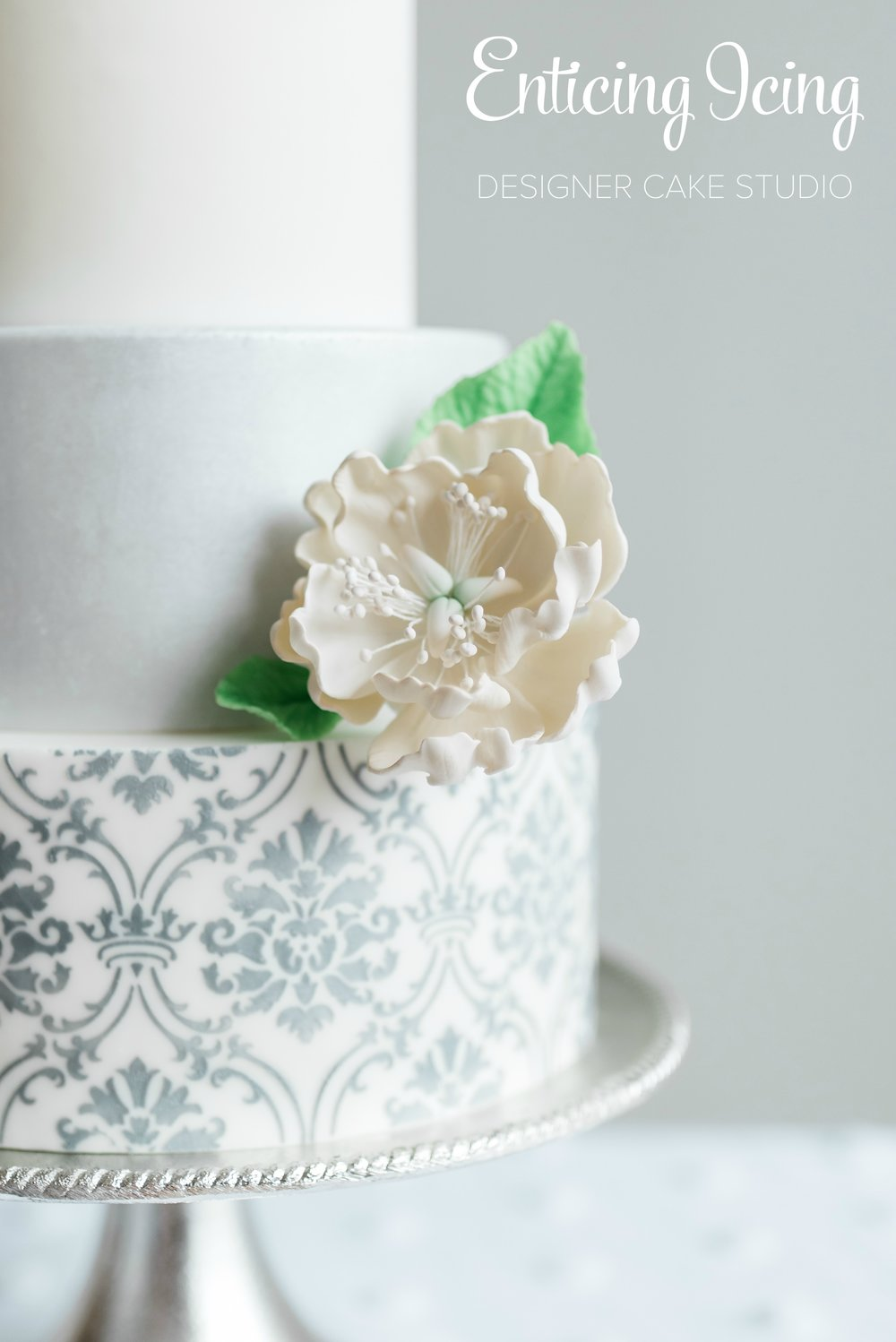 Three tier white fondant wedding cake with silver filigree damask stencil and open sugar peony | Enticing Icing, St. Paul/Minneapolis