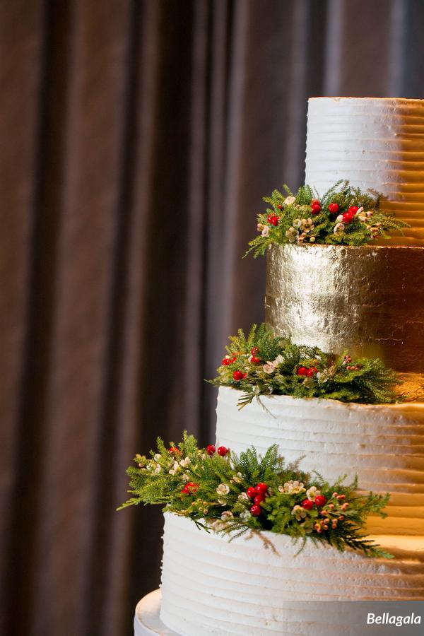 The cake was decorated with pine and holly berries to match the rest of the decor.  Thanks to Couture Fleur for preparing these lovely floral sprays in advance!