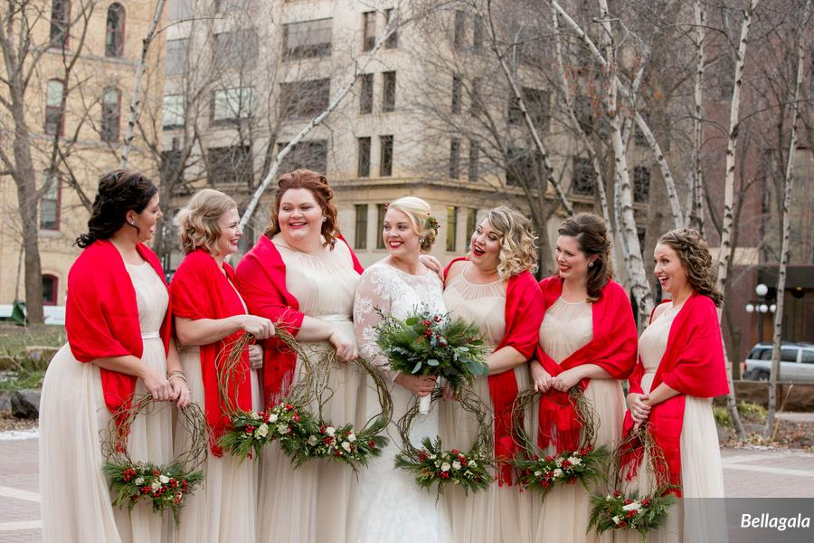 The bridemaids' shawls add a welcome pop of red.