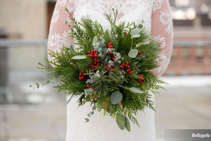 A unique bridal bouquet perfectly suited for a holiday wedding.