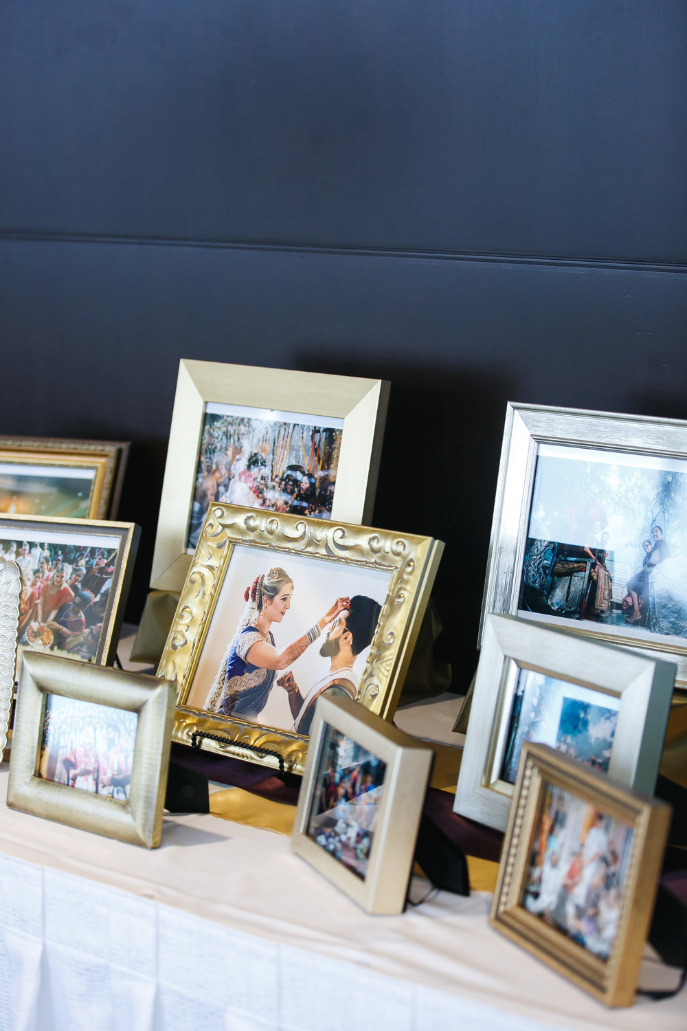 Photos from their Indian ceremony were displayed for their Minneapolis friends and family to see. Captured by  Bravado Weddings .
