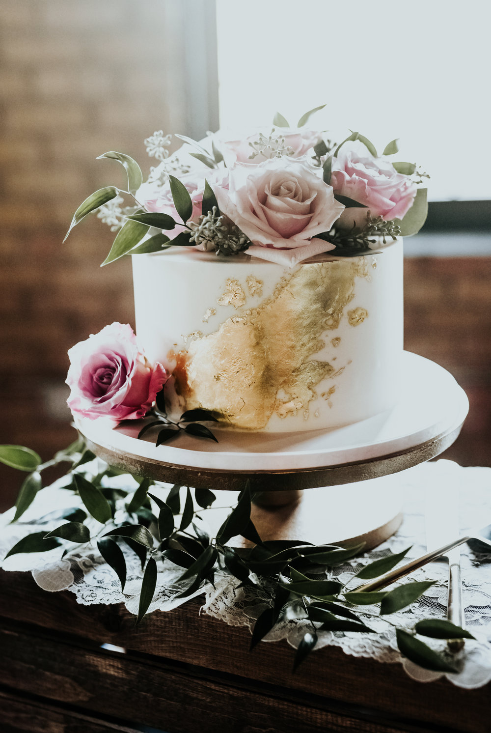 One of my favorite cakes of all time. Sweet and simple, yet undeniably elegant. 23K edible gold leaf adds a touch of luxury to any design!
