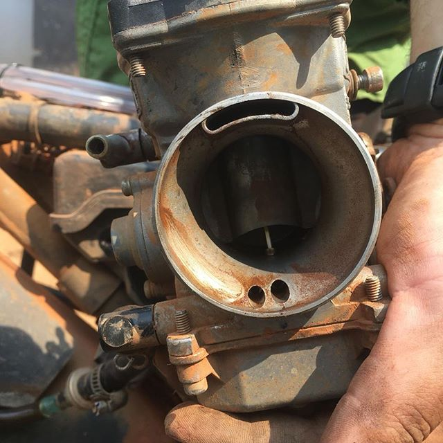 Does this carburetor seem dirty to you? 😂  Jamie's bike died and this was the culprit. I guess the last 1000 miles of dirt, dust, mud and falling in water finally got us. Thankfully it wasn't too hard to diagnose or fix.  #klr650 #advrider #motorcycletravel #adventure #africa #congo #carburetor #mechanic
