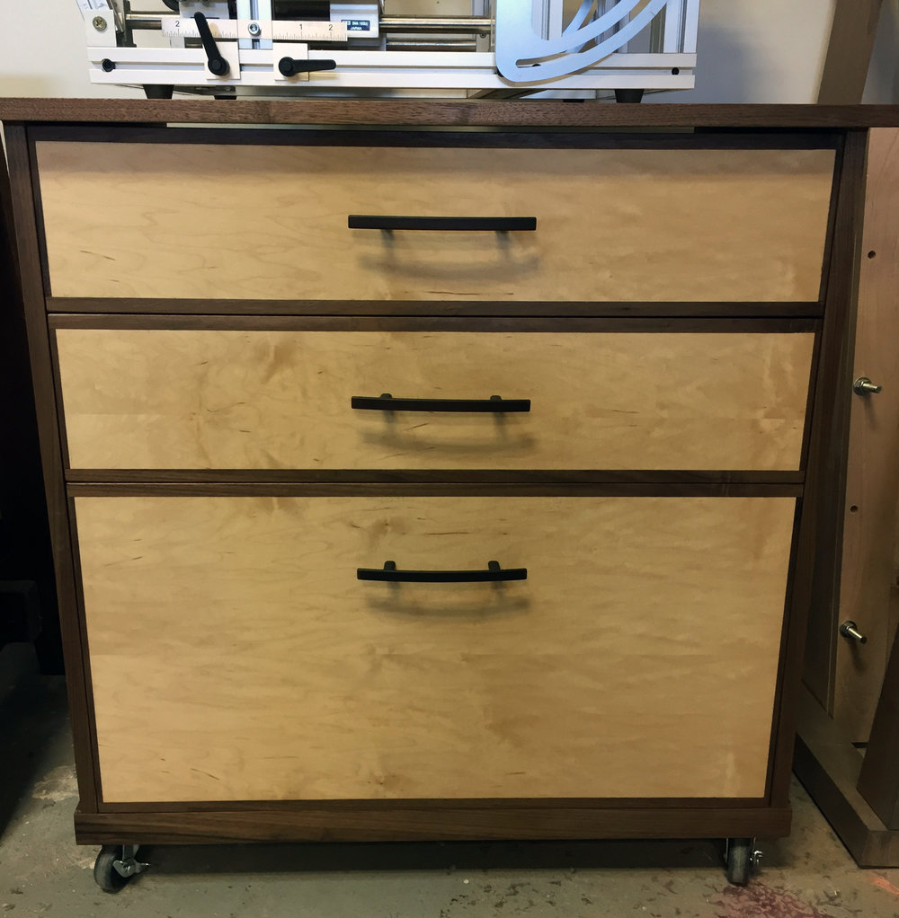 Matched drawer fronts, casters and plenty of storage make this cart functional and beautiful.
