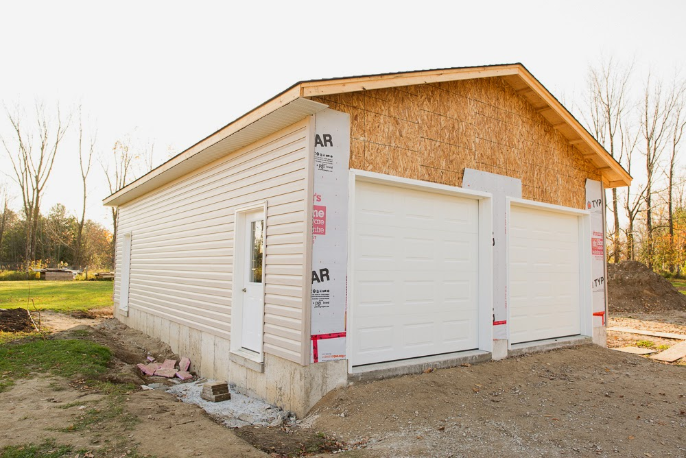 JCB and Sons carpentry building new construction builder west grey durham owen sound ontario garage new home constructor concrete finishing power trowel framing siding soffit fascia eavestrough