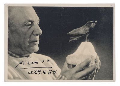 Lot 60 PICASSO PABLO Photograph Postcard Dated And Signed Picasso Showing A Close Up Of The Master Holding Sculpture Bird By Its Stone Base