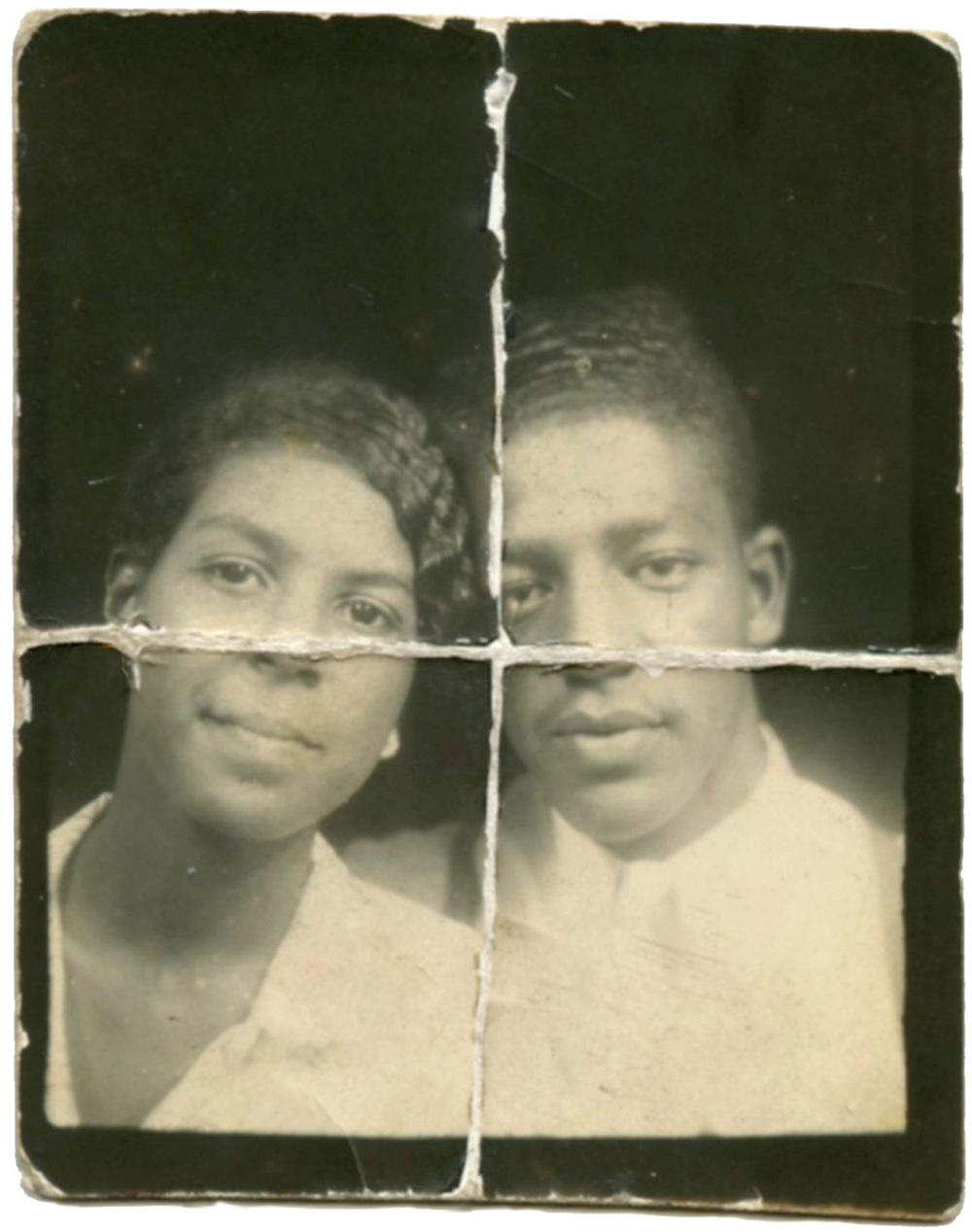 Neatly folded in halves, this photo booth image appears as if the couple is viewing us through a window.