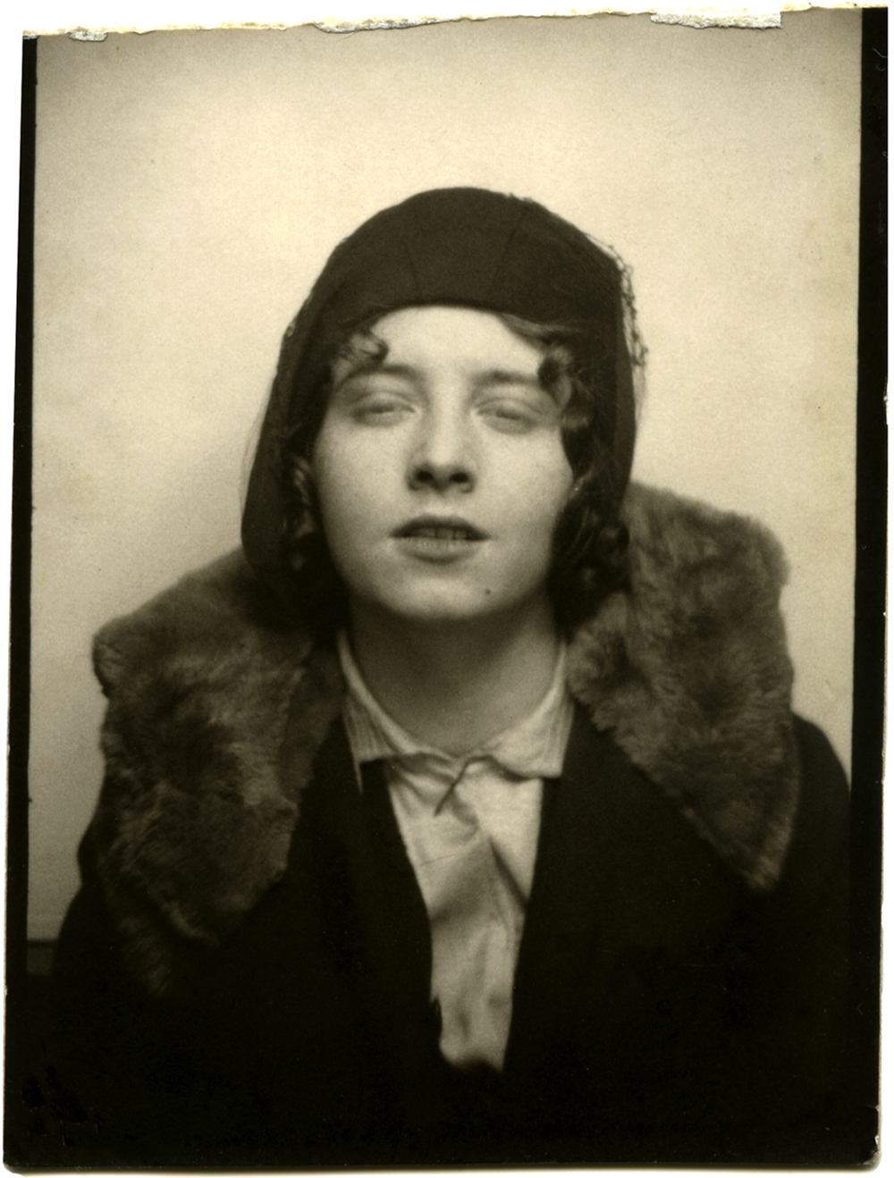 Photo booth of a 1920s Flapper Girl, with fur collar and bedroom eyes.