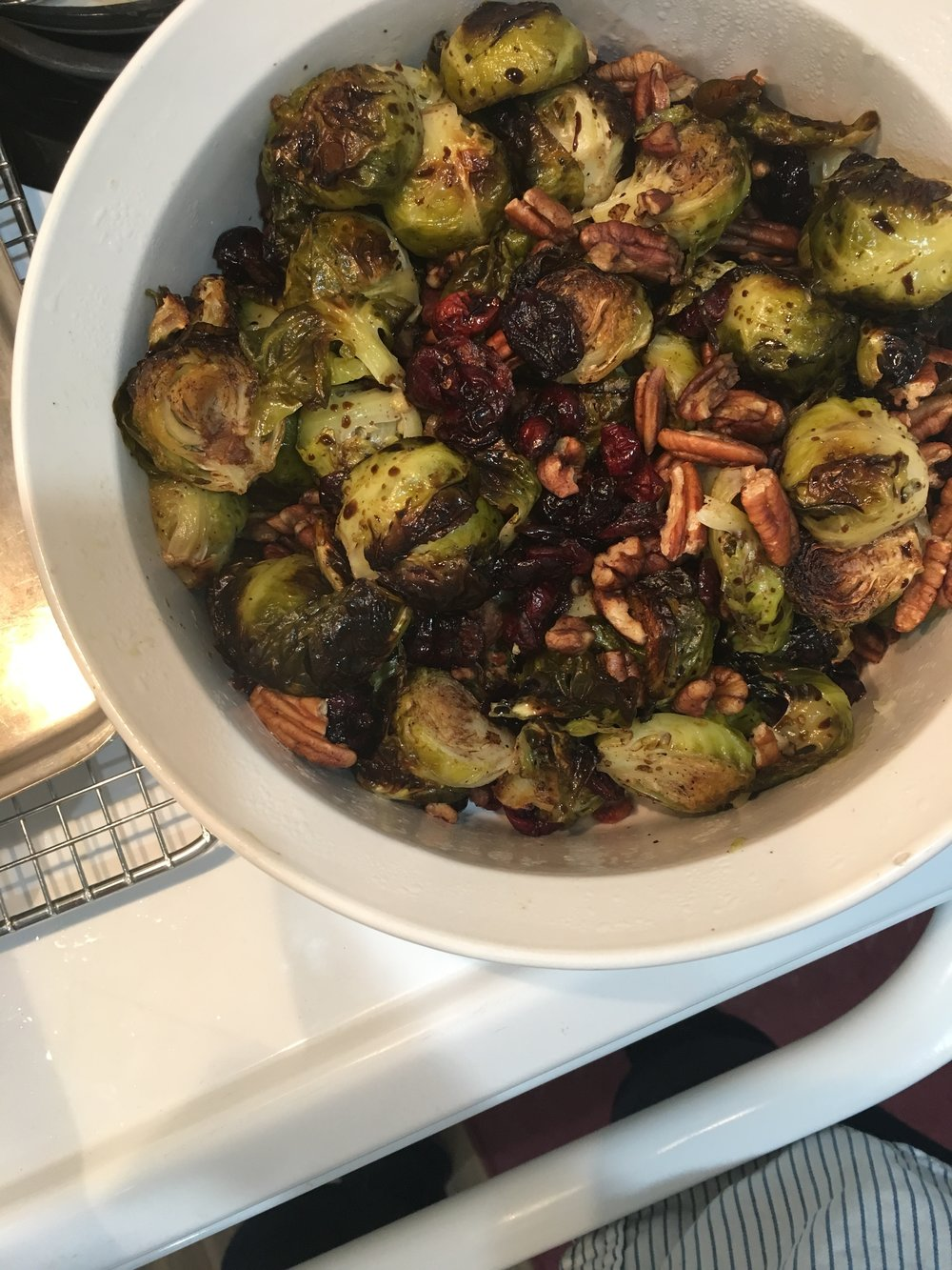 a thanksgiving dish of brussels with cranberries & pecans