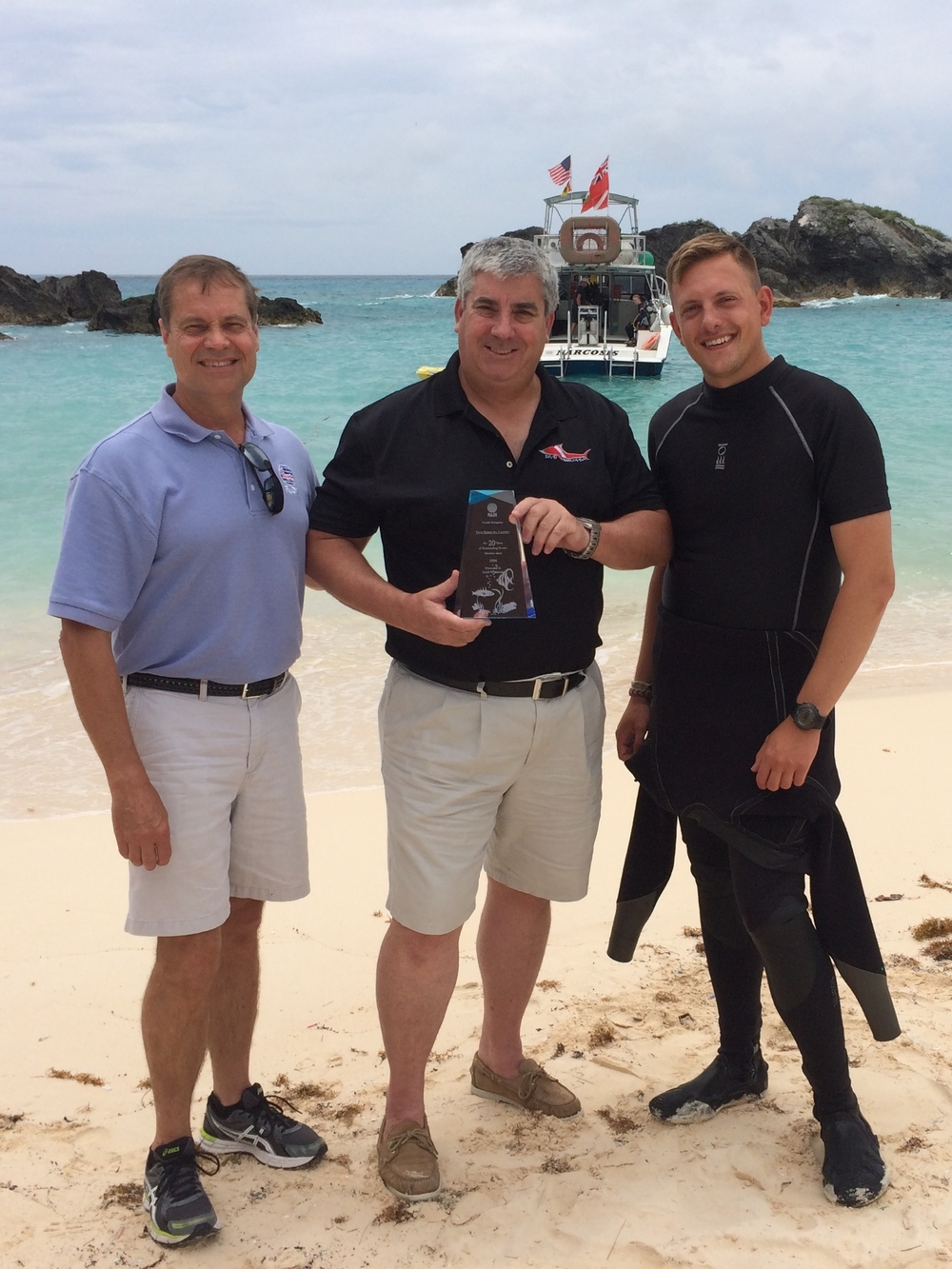 Owner Mark and instructor Matt receiving an award for 20 years of outstanding service from PADI Regional Manager Bill Hamm.