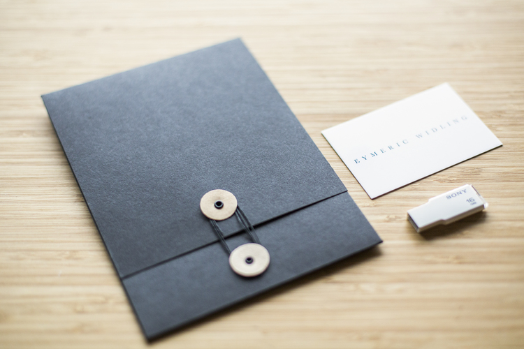 Eymeric widling diy button string envelopes the classic black envelope and button string are timeless and simple since the business card and usb drive are both white it makes a nice contrast to have reheart Choice Image