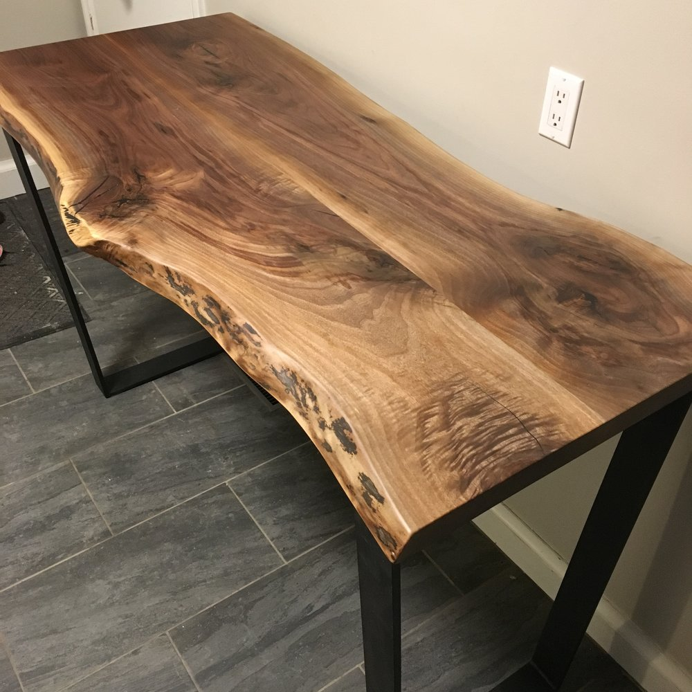 Live edge walnut top with steel square base
