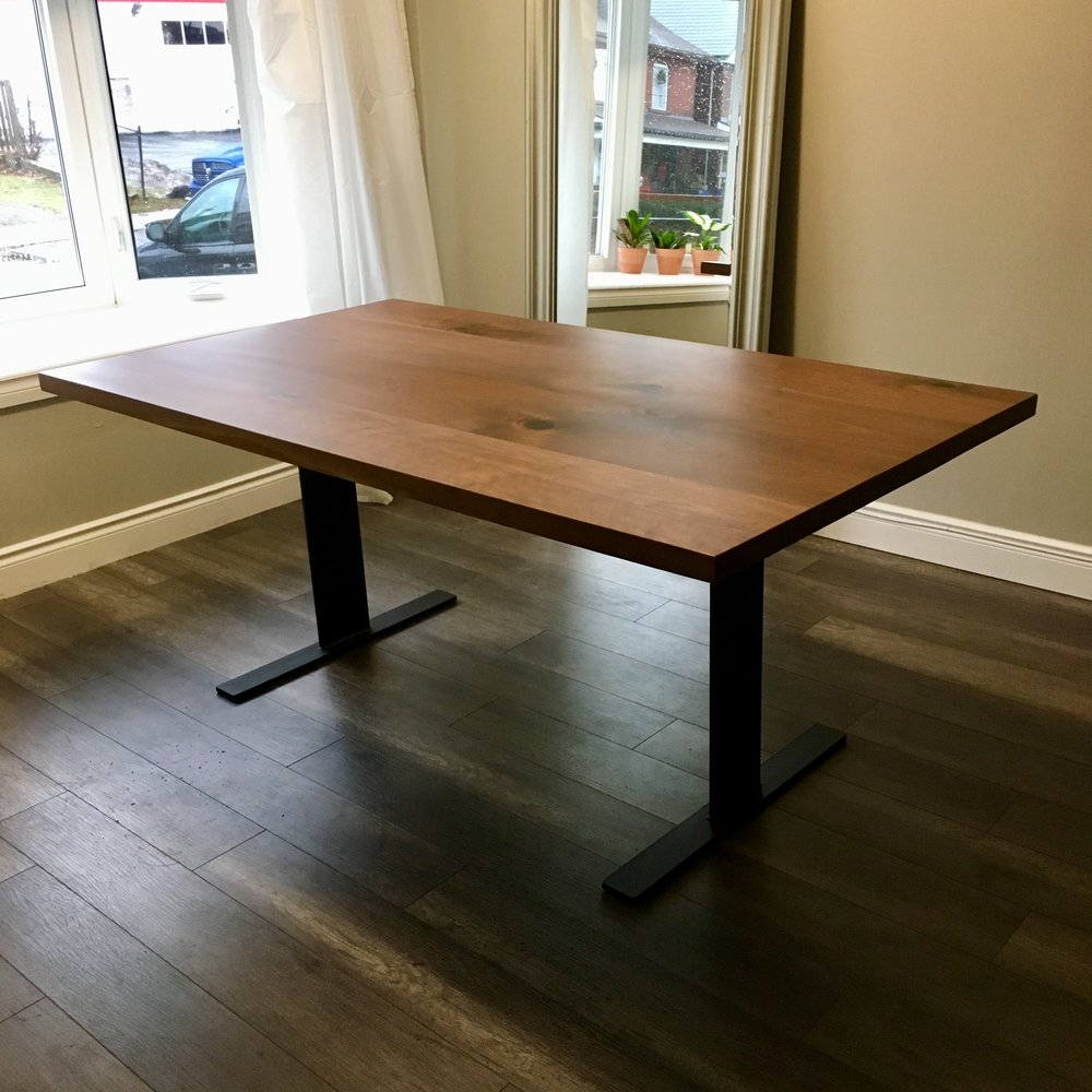 Straight edge walnut top with flat pedestal base