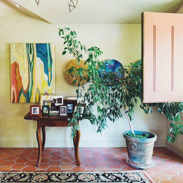 A Provence-inspired morning at the Reyering-Walker residence in Woodside, California. Painting by SF-based artist Courtney Stock. #provence #entryway #woodside #interiordesign #dutchdoor #art #watercolor #painting