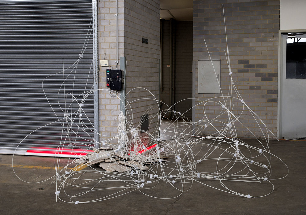 not an endless bounty, 2017. NotFair, Windsor. Fibreglass poles, sandstone, rope, light. Dimensions variable. Photo: Theresa Harrison.