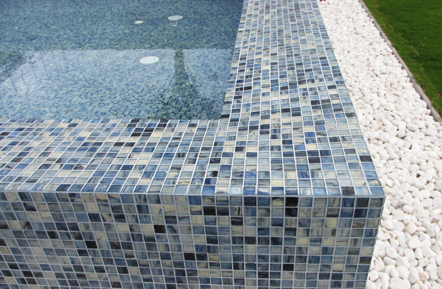 Pool installation at a villa resort in Sanya, China, using Sirocco 25x25mm matte (25M) glass mosaic.