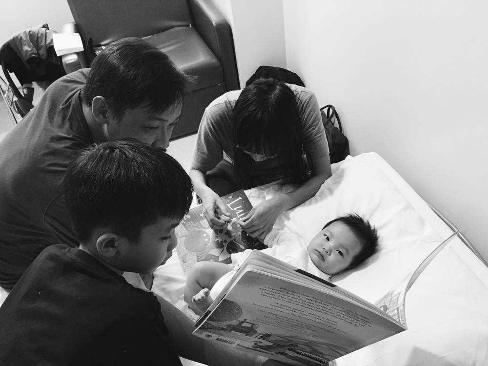 Pastor reading a bedtime story to him as a distraction from the nail-cutting that's happening! Hahaha. It worked! Well, for awhile at least.