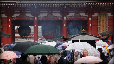 The rainy temple grounds with the sea of umbrellas