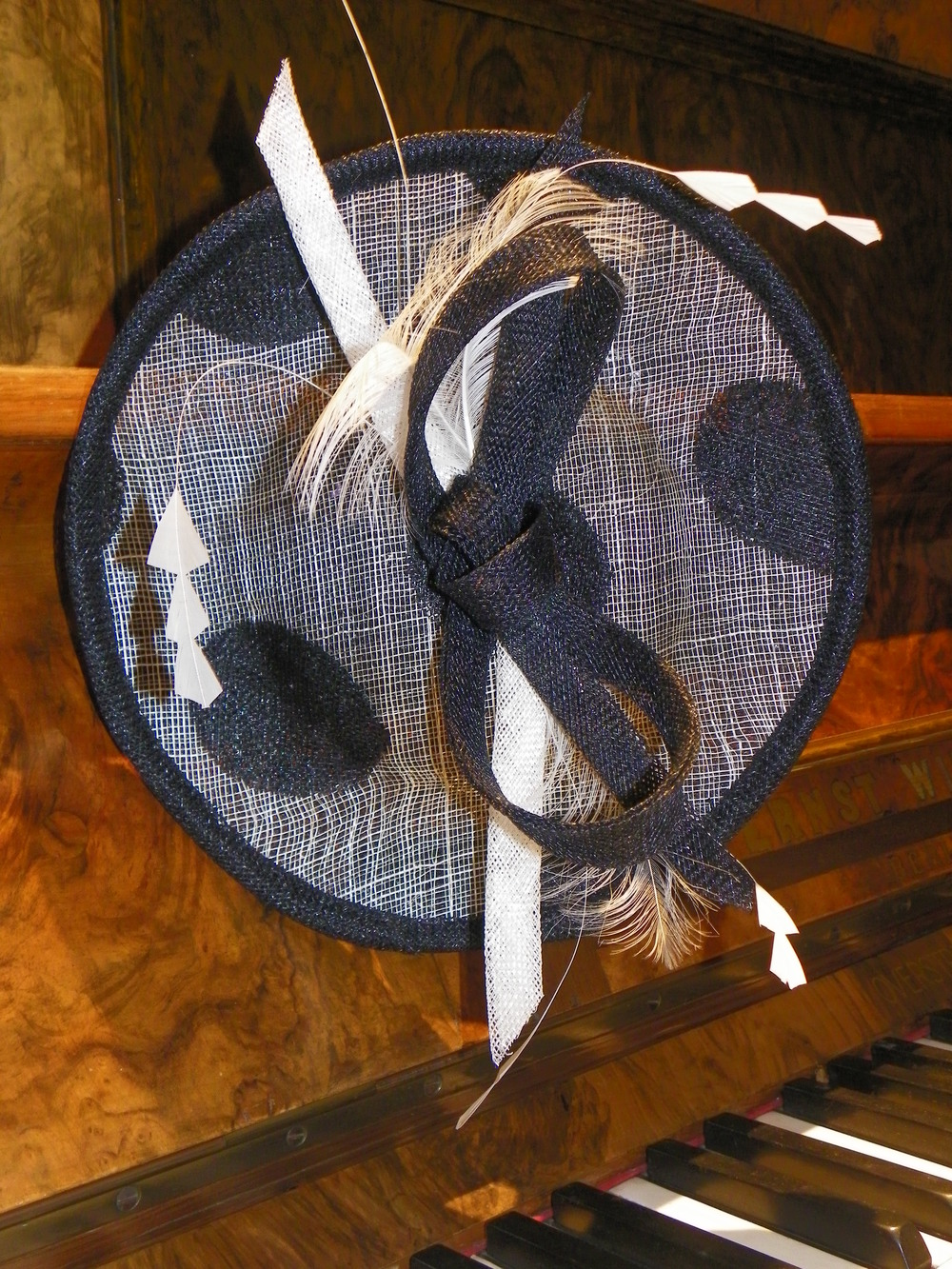 Mini saucer hat with spot sinamay overlay