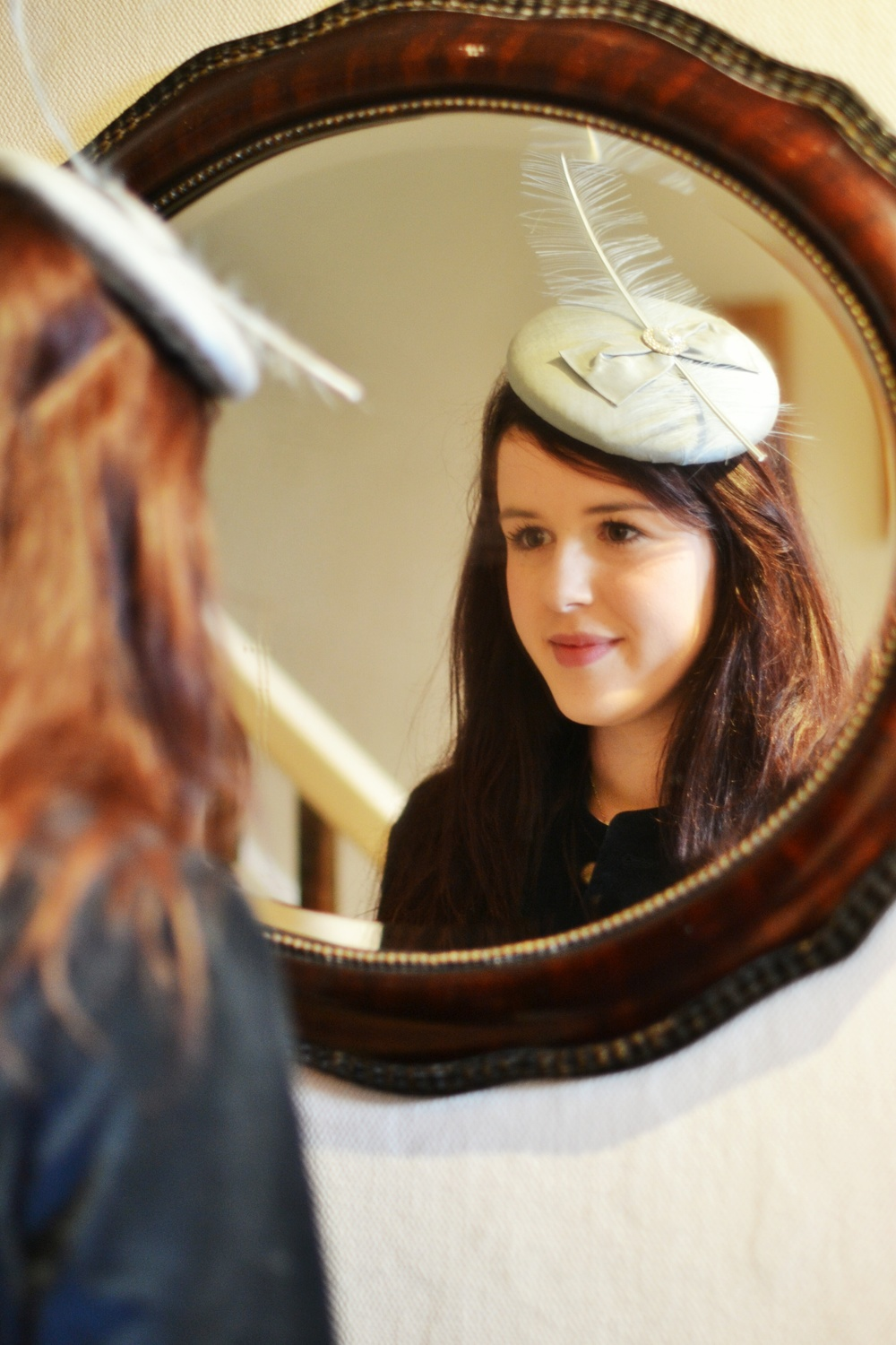 Silk button hat with flat bow, stripped ostrich feather and embellishment