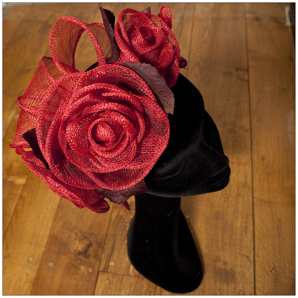 Rose headpiece hand rolled sinamay roses on oval base with handmade leaves and sinamay loops