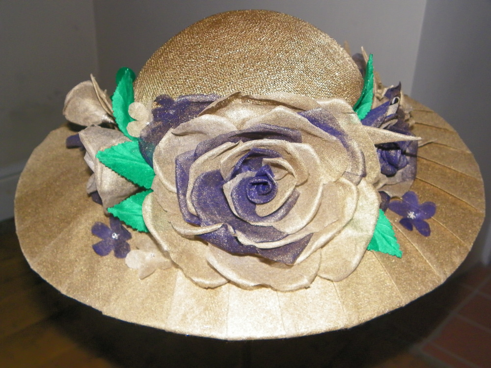Gold bell hat with organdie pleated brim and hand tooled roses
