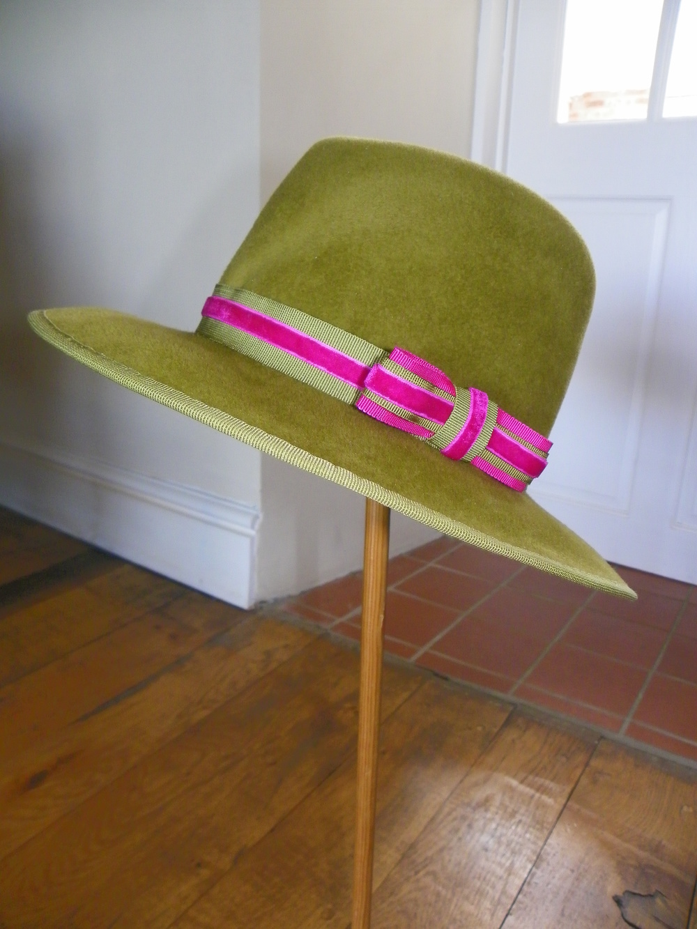Peachbloom trilby hat in olive green and pink velvet edging
