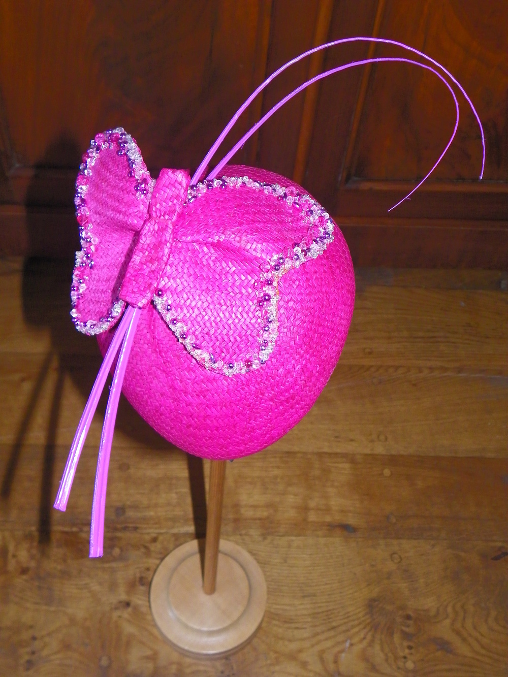 Hand blocked paper berret style headpieces with hand beaded butterfly and curled quills