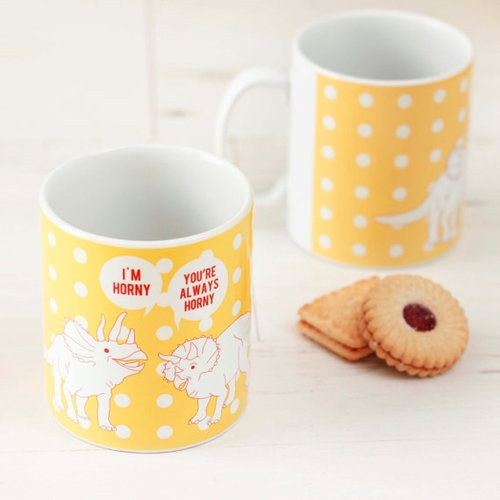 "13. ""ALWAYS HORNY"" DINOSAUR MUG €12.50 A fun gift for the lover or dinosaur lover in your life! Sunshine yellow mug illustrated with two triceratops - one remarking ""I'm Horny!"" and the other replying ""You're Always Horny."" Get it?! Lol puns,"